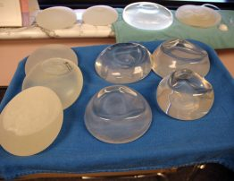 various breast implants as samples on a tray in  a doctors office